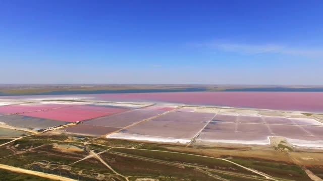 aerial: salt production in salt ponds - evaporation stock videos & royalty-free footage