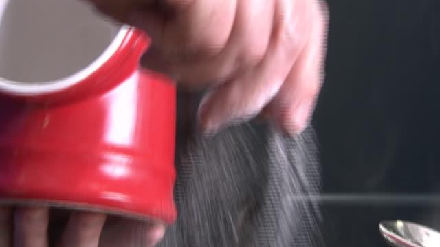 salt taken from a salt pig and sprinkled - sprinkling stock videos & royalty-free footage