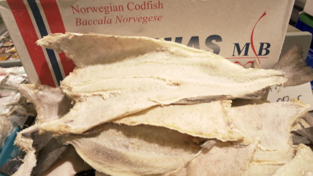 salted norwegian cotfish for sale at british fish market - fish stock videos & royalty-free footage