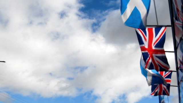 saltire flag and union jack flutter in the wind on march 9, 2017 in glasgow,scotland. nicola sturgeon has said in an interview that the autumn of... - scottish flag stock videos & royalty-free footage