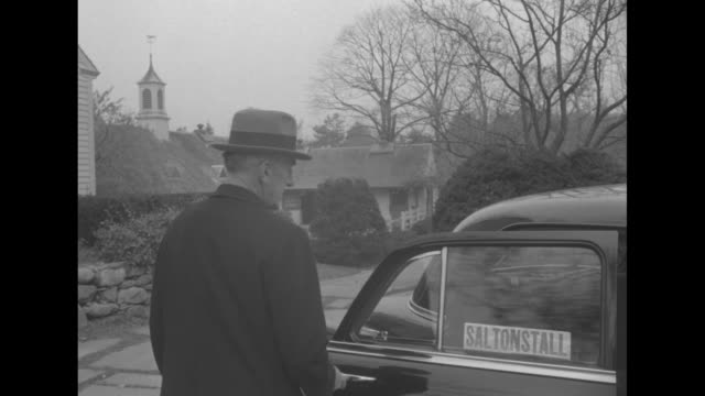 saltonstall home in dover with a station wagon parked to the side / he shuts door with a sticker with his name / he with house and car in background... - sticker stock videos and b-roll footage