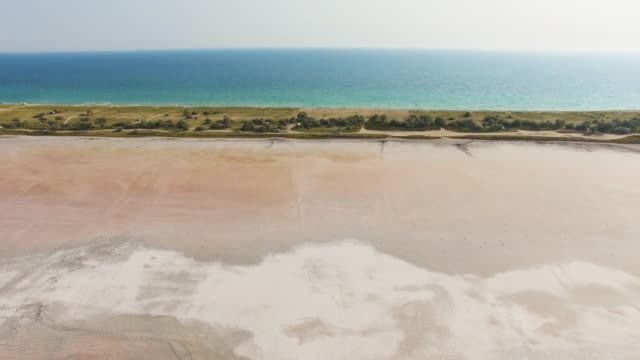 aerial: salty land between the sea and salt lakes - backwater stock videos & royalty-free footage
