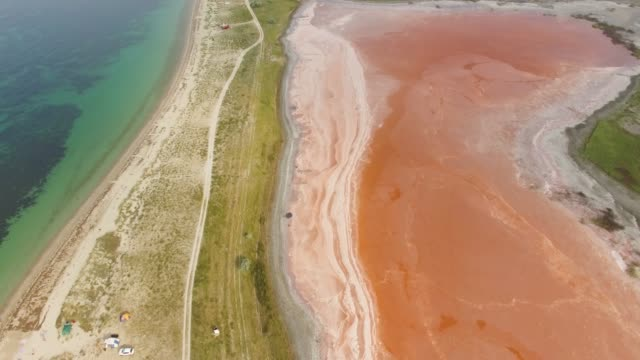 AERIAL: Salty land between the sea and salt lakes