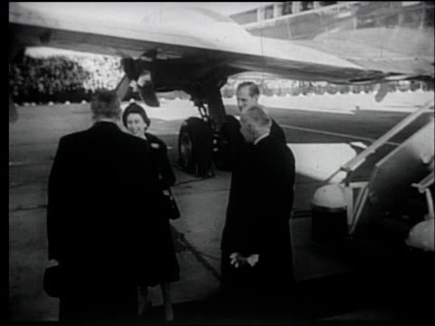 saluting canadian mountie as queen elizabeth ii and prince philip deplane from airplane / queen reviews military formation. queen elizabeth ii visits... - 1957 stock-videos und b-roll-filmmaterial