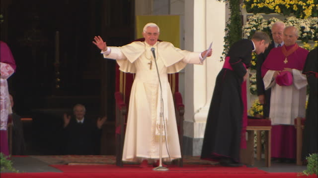 saluting the crowd of pope benedict xvi - pope stock videos & royalty-free footage