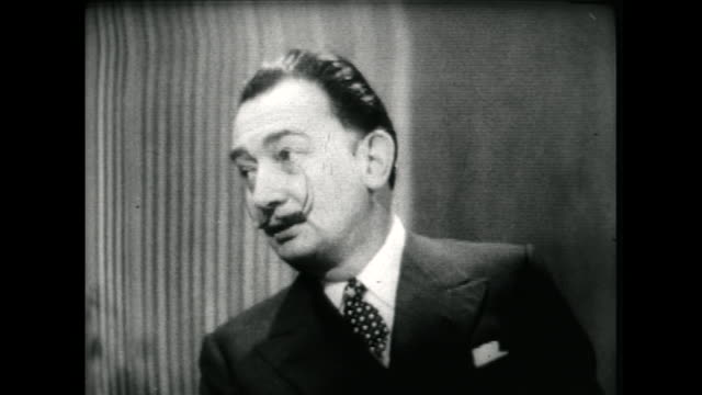 salvador dali speaking in 1955 on his excitement for the 'modern atomic age' and learning about nuclear physics - audio available stock videos & royalty-free footage