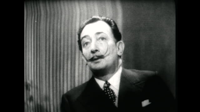 salvador dali speaking in 1955 on how his interest in psychoanalysis and sigmund freud is beginning to change and become focused on nuclear physics - audio available stock videos & royalty-free footage