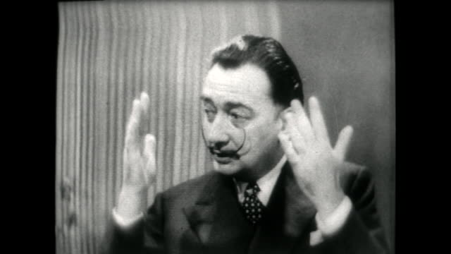 salvador dali speaking in 1955 on painting sir laurence olivier's portrait in only 5 minutes and saying olivier spends longer in the makeup chair for... - audio available stock videos & royalty-free footage