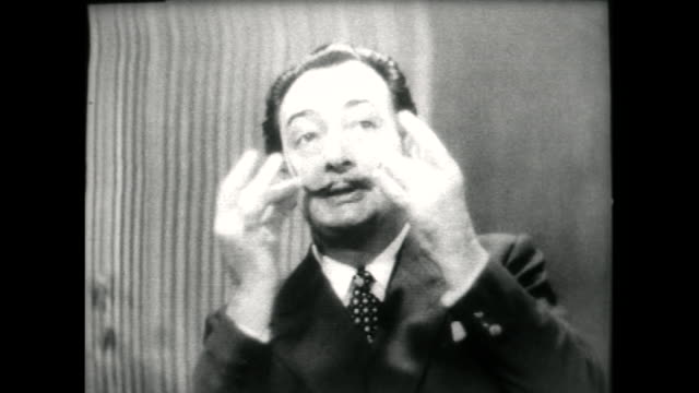 salvador dali speaking in 1955 on the origins of his iconic 'pencil' moustache and using leftover date syrup to style it after dinner one day - audio available stock videos & royalty-free footage