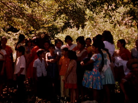 salvadorian civil war: government troops continue civilian killings; el salvador: ext children and guerrilla: ekta fire burning - government stock videos & royalty-free footage