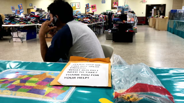 A Salvadorian immigrant makes a free call to relatives while taking shelter inside the Immigrant Respite Center on March 16 2017 in McAllen Texas The...