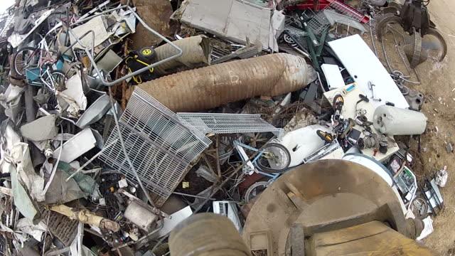 Salvage Yard Magnet Picking Up and Releasing Scrap Metal