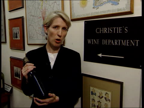london christie's pan across full auction room gv telephone buyers gv auctioneer with member of christie's staff next with bottle of champagne as sot... - versteigerung stock-videos und b-roll-filmmaterial