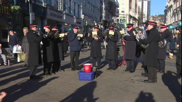 salvation army band playing christmas songs in a high street - salvation army stock videos & royalty-free footage