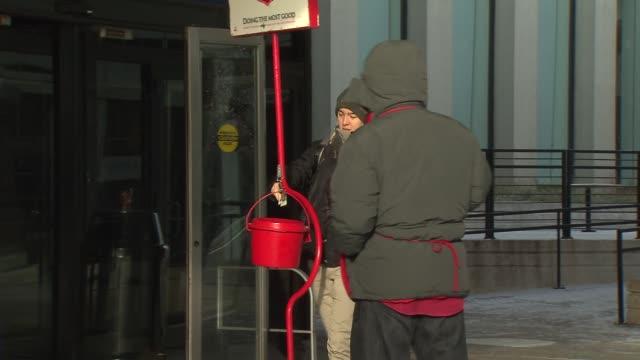 salvation army bell ringer at union station on december 24, 2013 in chicago, illinois - salvation army stock videos & royalty-free footage