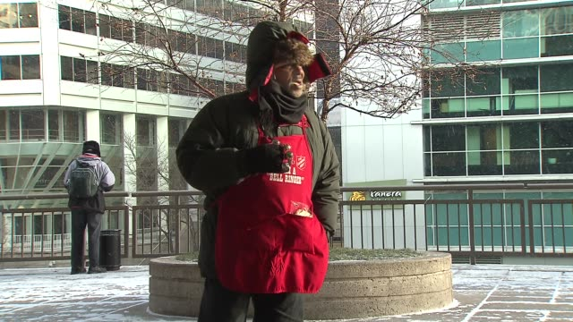 salvation army bell ringer at union station on december 24 2013 in chicago illinois - union army stock videos & royalty-free footage