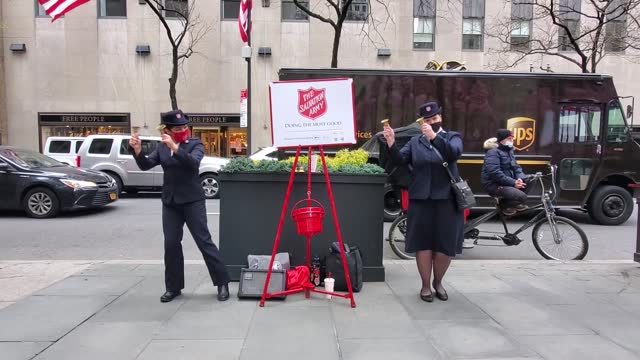salvation army bell ringers dance while collecting donations at rockefeller center on november 21, 2020 in new york city. - salvation army stock videos & royalty-free footage