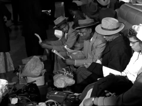 a salvation army officer chats to newly arrived west indian immigrants at southampton docks - southampton hampshire stock-videos und b-roll-filmmaterial