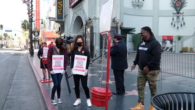 salvation army volunteers takes part in the salvation army and tcl chinese theatre host red kettle drive-thru donation event at tcl chinese theatre... - salvation army stock videos & royalty-free footage