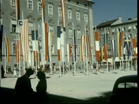 1950 salzburg, austria. main square with flags - austrian culture stock videos & royalty-free footage