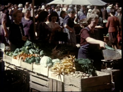 1950 salzburg, austria. various scenes including market - austrian culture stock videos & royalty-free footage