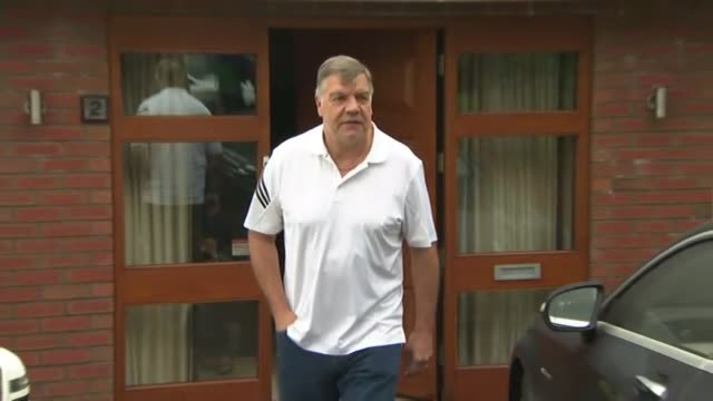 sam allardyce claims entrapment has won england greater manchester bolton ext man out of door carrying suite cases / sam allardyce out of door and... - bolton greater manchester stock videos and b-roll footage