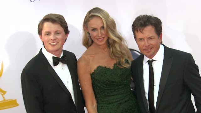 sam fox tracy pollan michael j fox at 64th primetime emmy awards arrivals on 9/23/12 in los angeles ca - michael j. fox stock videos and b-roll footage