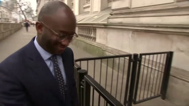 stockvideo's en b-roll-footage met sam gyimah mp walking down whitehall and into downing street - bbc archives