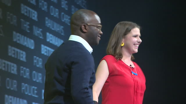 sam gyimah who has defected to the liberal democrats from the conservative party joins leader jo swinson on stage at the party conference bournemouth - politician stock videos & royalty-free footage