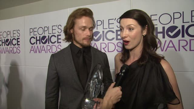 INTERVIEW Sam Heughan Caitriona Balfe on what this particular award means to them at People's Choice Awards 2015 in Los Angeles CA