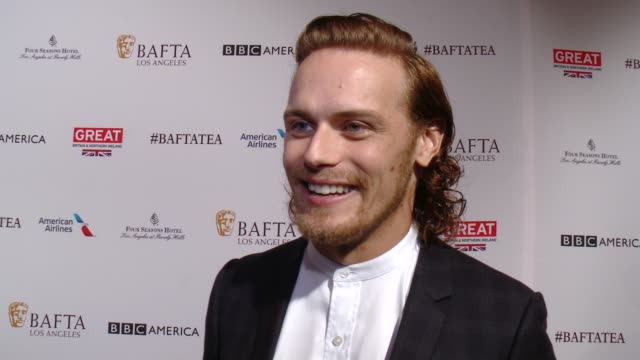 vídeos de stock, filmes e b-roll de interview sam heughan on being at the event and on rooting for his castmates at the golden globes at the bafta los angeles awards season tea party at... - tea party