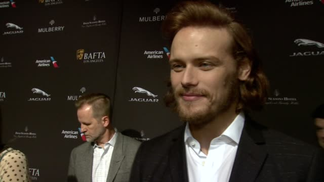 vídeos y material grabado en eventos de stock de interview sam heughan on being at the event on what makes the bafta tea party one of the most prestigious events of the weekend and on getting ready... - acontecimiento