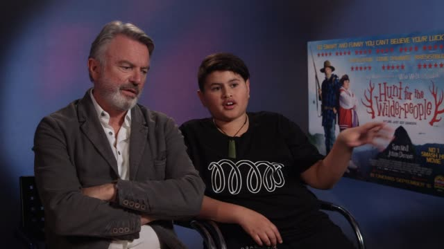 INTERVIEW Sam Neill Julian Dennison on if dinosaurs would have enhanced the film filming on an army training site at 'Hunt for the Wilderpeople'...