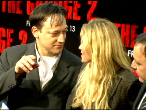 Sam Raimi Lucy Lawless and Ted Raimi at the 'The Grudge 2' premiere arrivals at Knott's Scary Farm in Buena Park California on October 7 2006