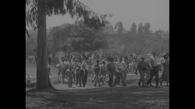 sam snead tees off at the us open championship match in pacific palisades ca / spectators approach green as others face them in foreground /... - pacific palisades stock videos & royalty-free footage