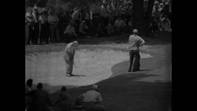 sam snead, wearing straw hat, drives ball at the pga championship / johnny palmer, wearing cap, chips out of sand trap / vs both golfers putt and... - pga stock videos & royalty-free footage