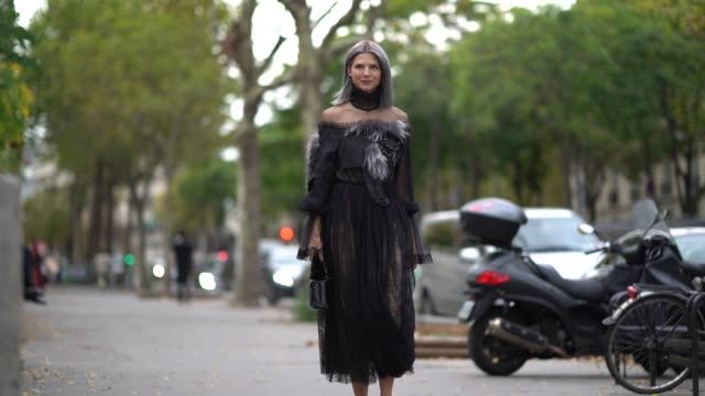 Samantha Angelo wears a black lace dress outside Andrew GN during Paris Fashion Week Womenswear Spring/Summer 2018 on September 29 2017 in Paris...
