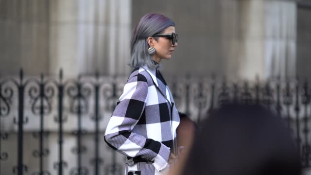 Samantha Angelo wears a checkered coat outside the Dries Van Noten show during Paris Fashion Week Womenswear Spring/Summer 2018 on September 27 2017...