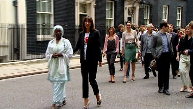 Samantha Cameron does charity walk for health workers ENGLAND London Downing Street EXT Samantha Cameron standing next to Dr Hajara Kera posing for...