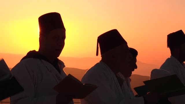 samaritan worshipers attend a passover ceremony wearing traditional white robes and red tarboosh at mount gerizim in the west bank city of nablus on... - passover stock videos and b-roll footage