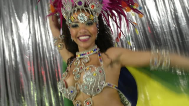 Samba dancer with Brazil flag