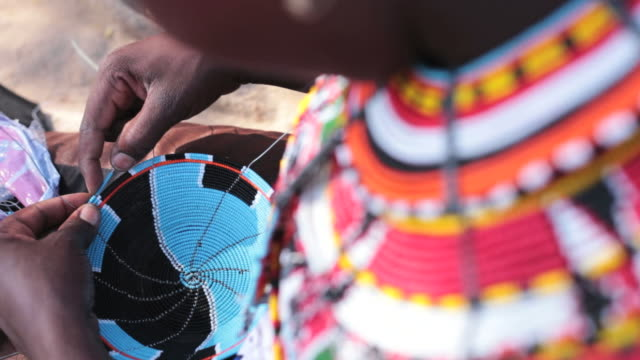samburu woman threading beads - craft stock videos & royalty-free footage