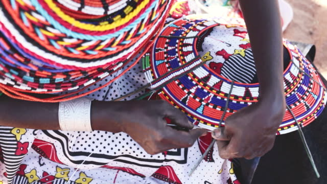 samburu woman threading beads - kenya stock videos & royalty-free footage