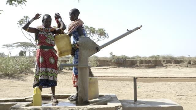 Samburu women collecting freshwater from borehole. Kenya, Africa.