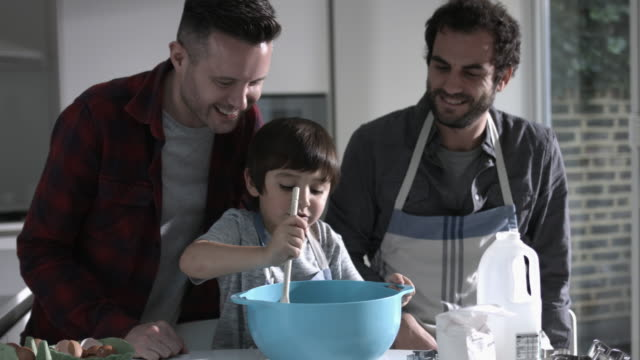 same sex couple family cooking biscuits - black hair stock videos & royalty-free footage