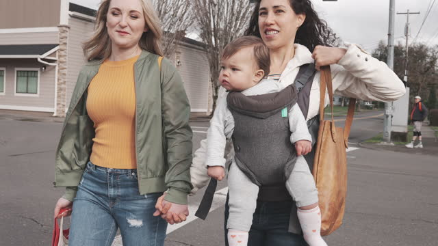 same sex couple with cute baby girl walking across street - pacific islanders stock videos & royalty-free footage