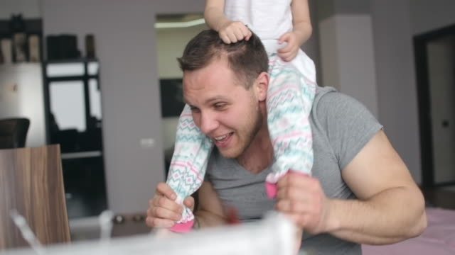 same-sex parents playing with happy adopted daughter - tickling stock videos & royalty-free footage