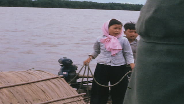 sampan crew hauling line to come alongside us navy inspection craft and crew standing on sampan deck / vietnam - sampan stock videos & royalty-free footage
