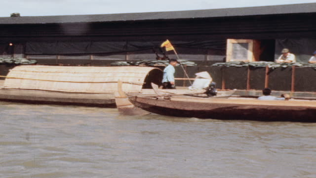 sampans tied up to barge complex crew exiting sampan and posing aboard / vietnam - sampan stock videos & royalty-free footage