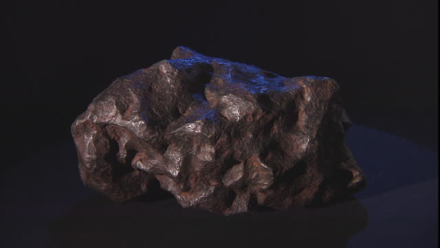a sample of a meteorite is displayed against a black background. - payson stock videos & royalty-free footage